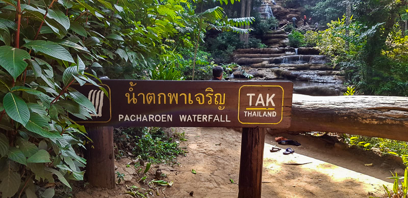 pha charoen waterfall sign travel is sweet